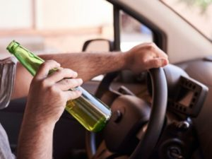 unrecognized man drinking while driving