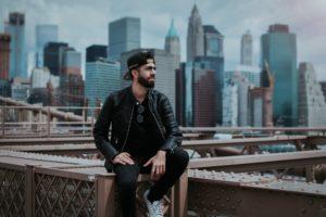 london based crypto advisor david azzato sits in front of a new york city backdrop